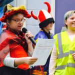Children reading at Christmas concert at school
