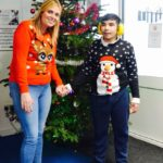 Student and teacher in Christmas jumper