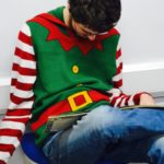 Student in Christmas jumper in library