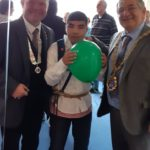 Young man with Hastings dignitaries at the Albany Taxi Party