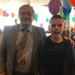 Mayor of Hastings with child attending the Albany Taxi party in Hastings