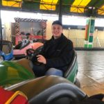 Young man on bumper cars at Hastings