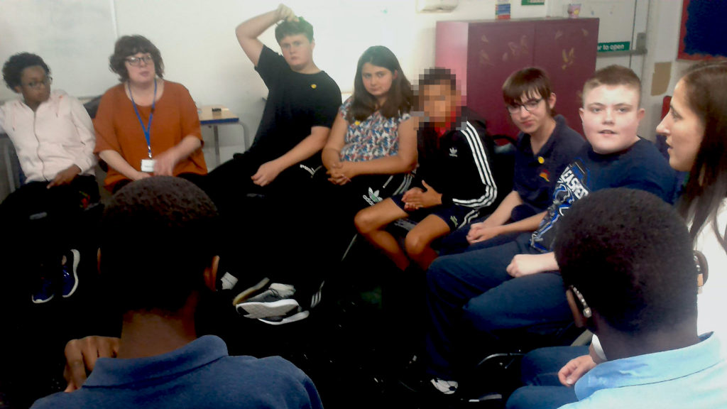 Students in a circle discussing philosophy