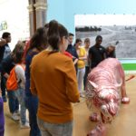 Students looking at artwork in the Summer Exhibition at the Royal Academy
