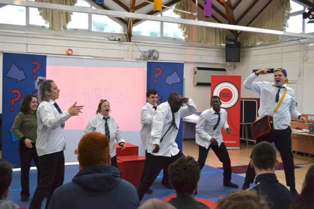 Actors dancing in school uniform