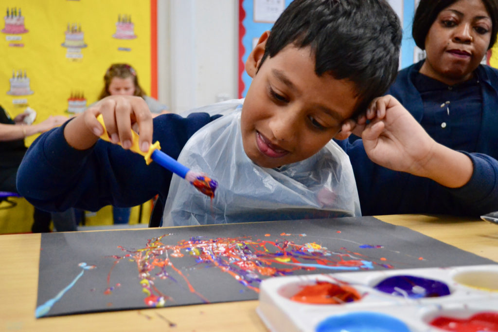 Child painting fireworks