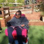 girl in wheelchair sunbathing