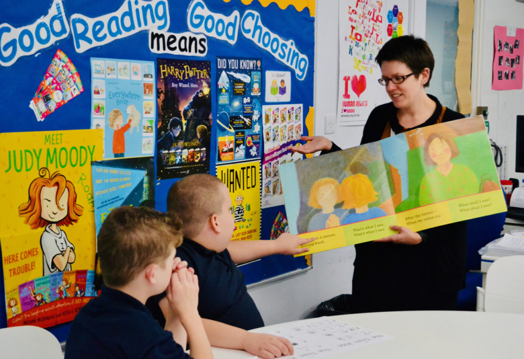 Children in library being read to