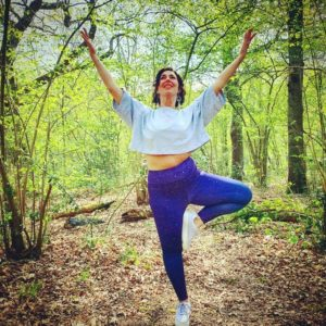 Lauren the yoga teacher in the woods