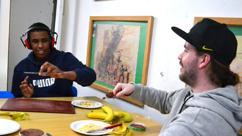 Boy and teacher with banana and icecream