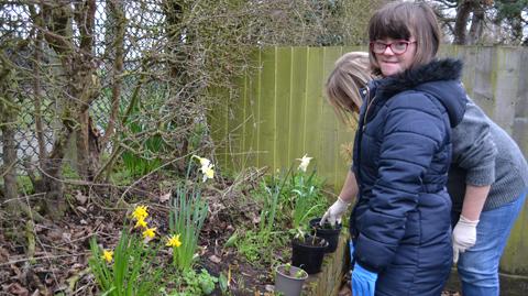 girl and teacher in garden