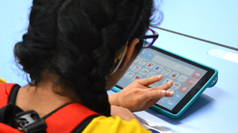 Girl using device for lesson