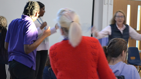 Students and teachers dancing