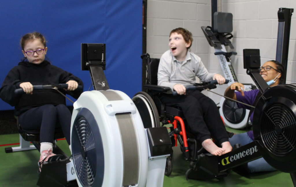 Two children on fitness machines