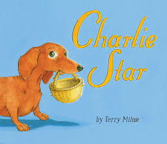 Cover of book called Charlie Star, with a dog holding a small basket in their mouth