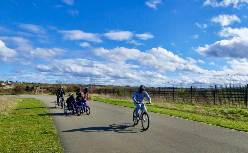 Young people riding bikes in an open space