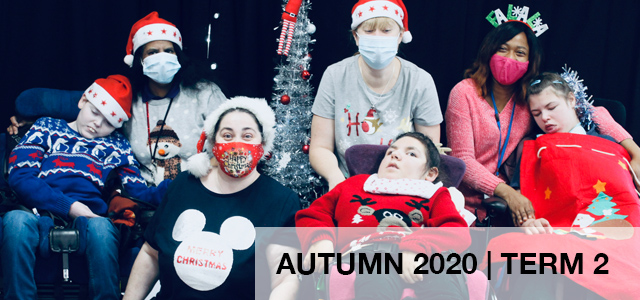 Christmas banner with students in wheelchairs and teachers